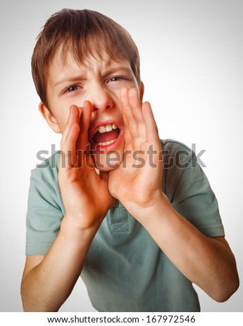 boy teenager calling cries kids shouts opened his mouth isolated on white background gray