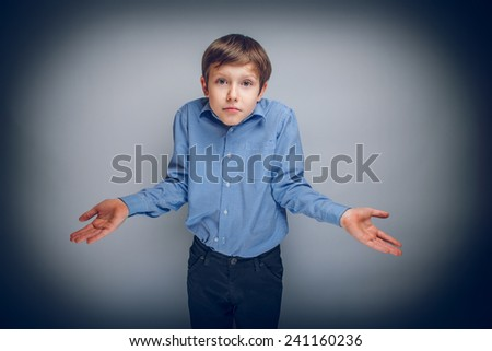 boy teenager of European appearance brown hair threw up his hands in disbelief cross process - stock photo