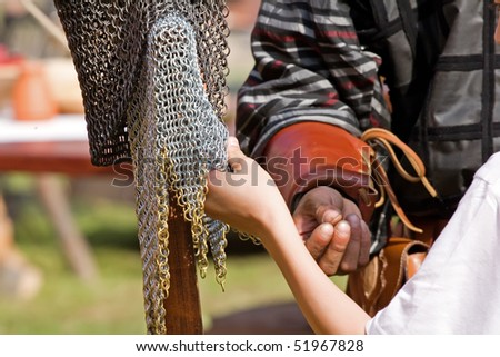 Boy touching chainmail