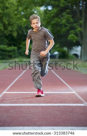 boy trained 100 m run_2 - stock photo