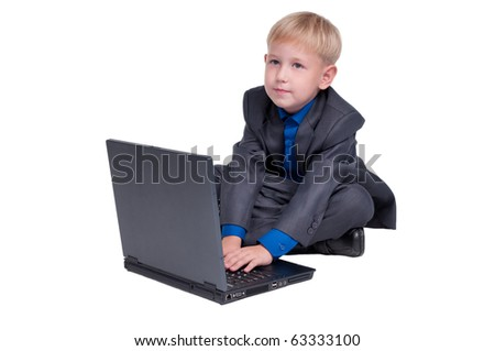 Boy typing on his laptop - stock photo