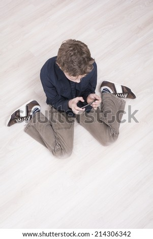 Boy using a smartphone