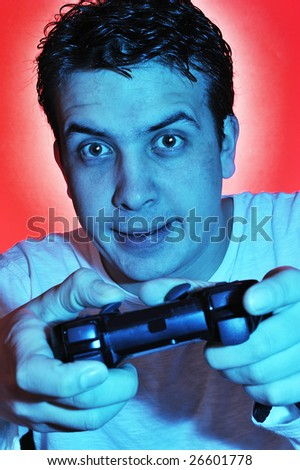 Boy using the video game controller - stock photo