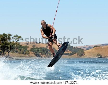 Boy Wakeboarding on the lake - stock photo