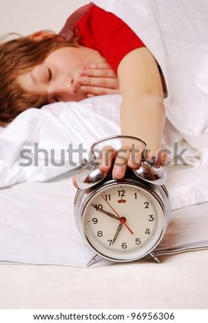 boy wakes up and yawning - stock photo