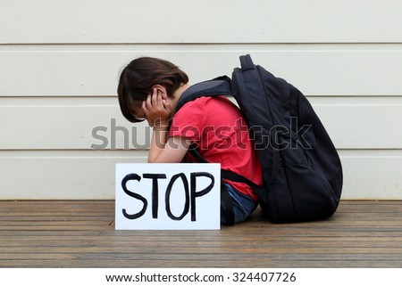 Boy wanting bullying to stop. - stock photo