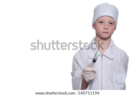 Boy was a doctor in a medical gown, cap, with syringe in hand on white background. Isolated on white. Place for text.
