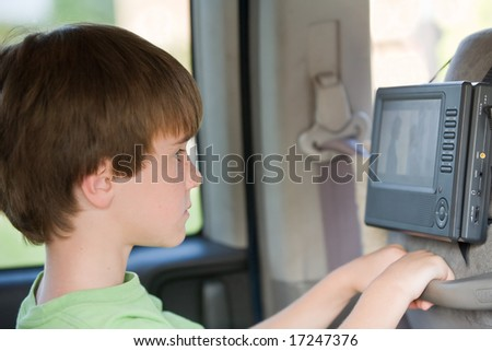 Boy Watching Movie in Van - stock photo