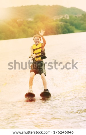 Boy water skiing - stock photo