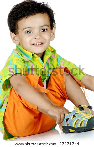 boy wearing shoe over white background - stock photo
