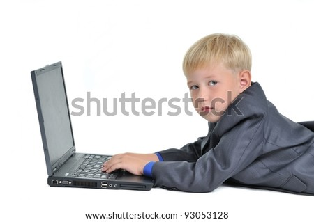 Boy wearing suit working on laptop, isolated on white background - stock photo