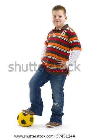 Boy wearing trendy colorful t-shirt, posing with football, smiling. Isolated on white background. - stock photo