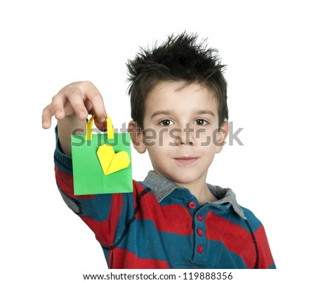 Boy who laughs and holds small shopping bag with heart. White copy spice - stock photo