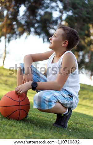 boy with a ball in the fresh air in the park summer - stock photo