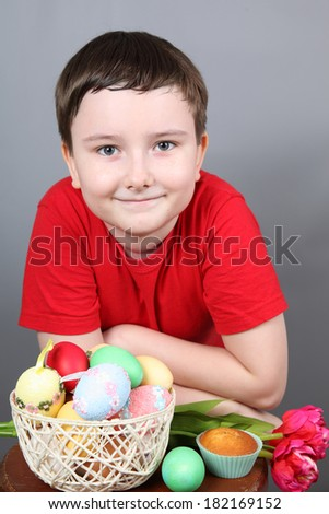 Boy with a basket of Easter eggs - stock photo