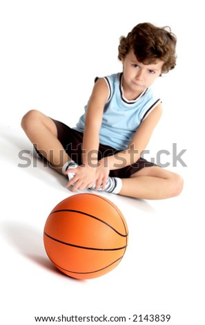 boy with a basketball ball  over a white background with the focus in the ball