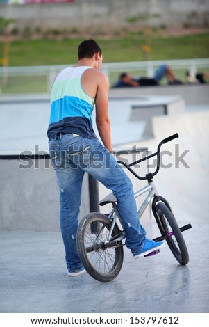 boy with a bicycle, a summer day - stock photo