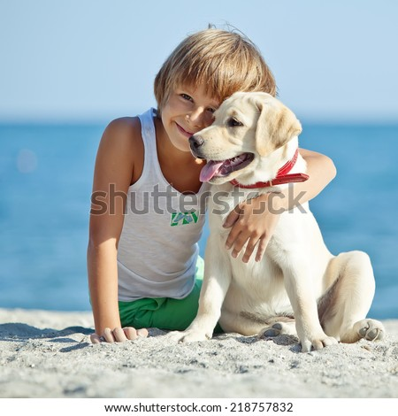 Boy with a dog on the nature