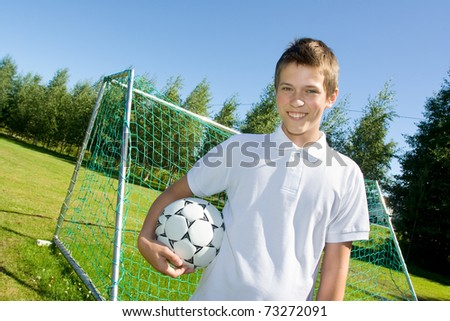 Boy with a football in hand - stock photo