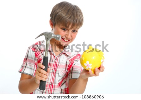 boy with a hammer breaking a piggybank against white background