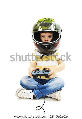 Boy with a helmet, using video game controller. Isolated on white background  - stock photo