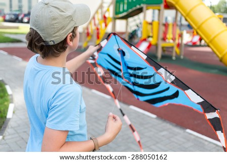 boy with a kite in his hands - stock photo
