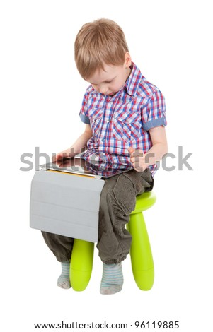 boy with a Tablet PC sitting on a chair in the studio isolated on white background