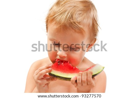 Boy with a watermelon on a white background