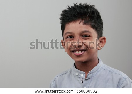 Boy with an open smile - stock photo