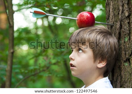 boy with apple on his  head and arrow shot through - stock photo