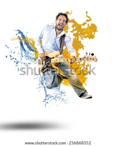 Boy with bass guitar jumps with fire and water - stock photo