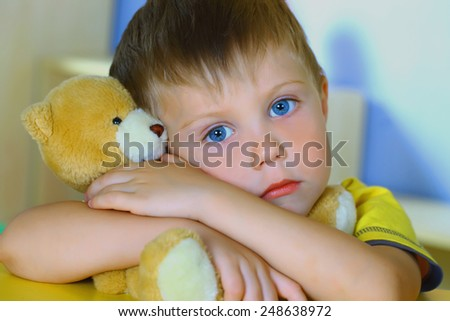 Boy with bear - stock photo