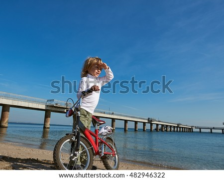 boy with bicycle on sea outdoor