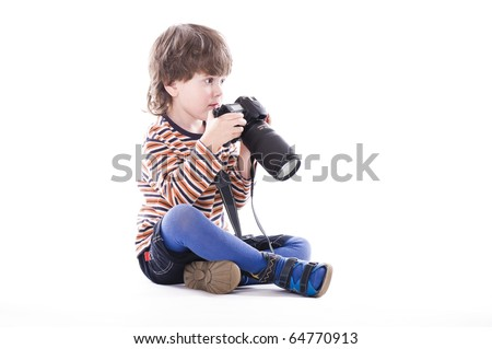 boy with big professional camera over white