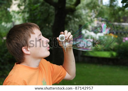 boy with big soap bubble - stock photo