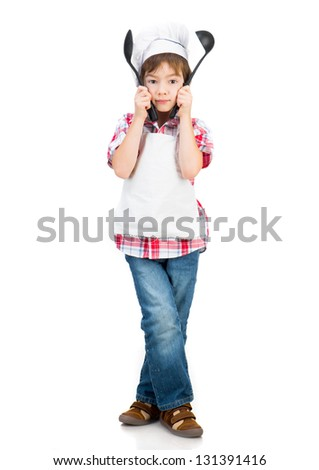 boy with black spoons isolated on white background - stock photo
