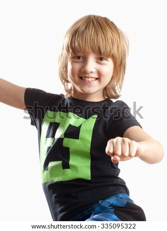 Boy with Blond Hair Smiling, Dancing to Music - stock photo