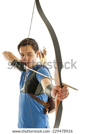 Boy with blue shirt and jeans shooting with a longbow - stock photo
