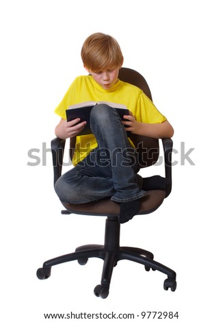 boy with book in armchair - stock photo