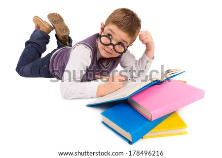 Boy with books for an education - stock photo