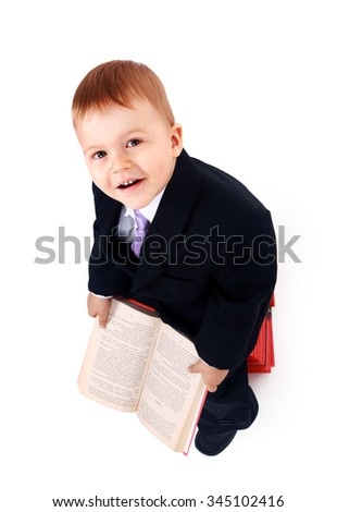 Boy with books for an education portrait - isolated over a white background - stock photo