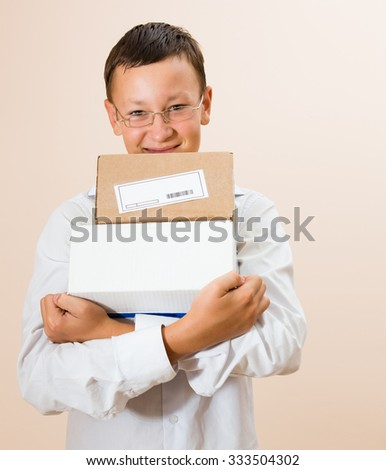Boy with boxes of parcels in the hands - stock photo