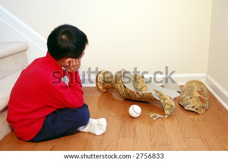 Boy with broken vase and baseball.