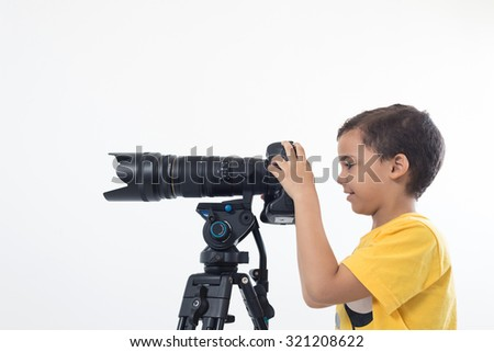 Boy with camera on White background - stock photo