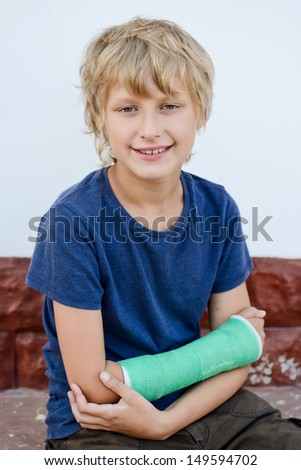 boy with cast on right hand - stock photo