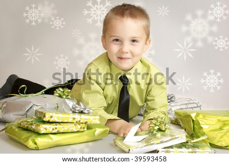 boy with christmas gifts - stock photo