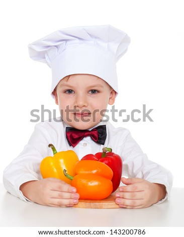 Boy with clothes cooks with vegetables
