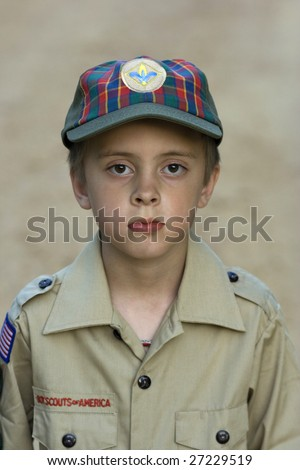 Boy with cub scouts uniform on - stock photo
