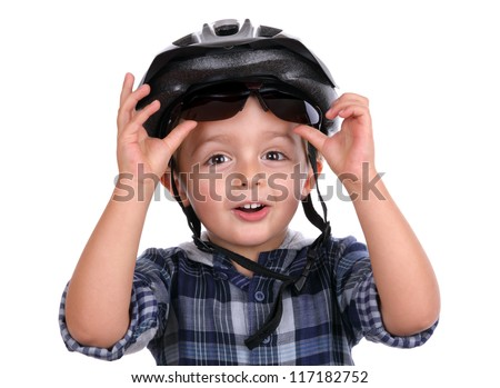 Boy with cycling helmet removing sunglasses - stock photo