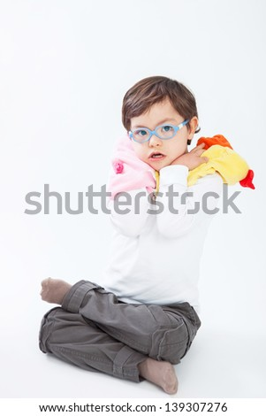 Boy with Down Syndrome playing with puppets - stock photo